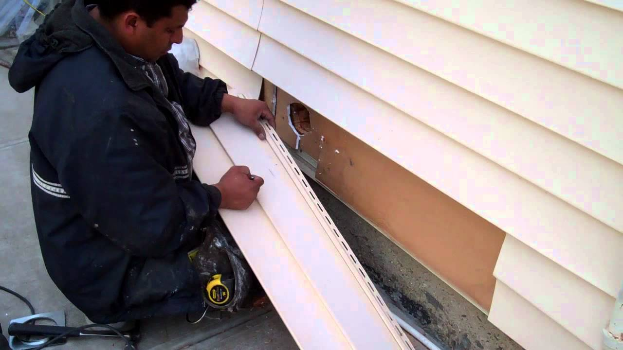 Making a dryer vent hole through vinyl siding Movie.wmv - YouTube