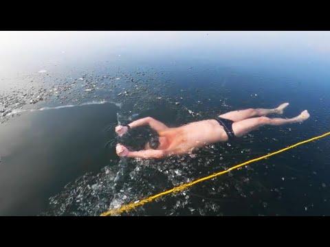 Man Swims Under Frozen Lake