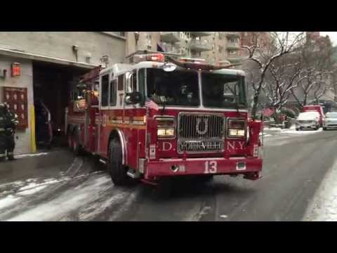 FDNY TOWER LADDER 13 RETURNING TO IT'S FIRE HOUSE ON E. 85TH ST. ON THE EAST SIDE OF MANHATTAN, NYC.