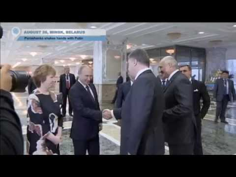 Poroshenko and Putin shake hands at Belarus summit
