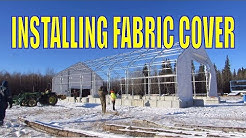 PREMIUM 40′ WIDE DOUBLE TRUSS FABRIC STORAGE BUILDING installing the cover