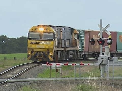Freight Train at Level Crossing in Victoria - PoathTV Railroads and Trains in Australia