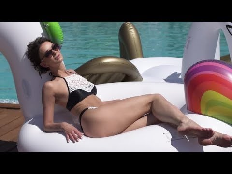 Young Woman in Swimsuit Sunbathing Lying on an Inflatable | After Effects template