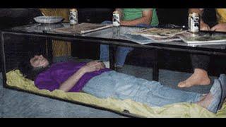 MAN KEEPS DEAD WIFE IN GLASS COFFEE TABLE