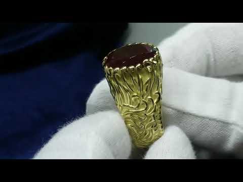 Золотой мужской перстень с крупным изумрудом