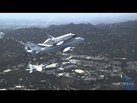 F/A-18 extended view of Space Shuttle Endeavour