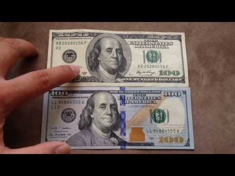 Comparing the new $100 US dollar (Oct 2013) with the old $100 bill.