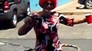 Cristy Cruiser hula-hooping before Dallas Gay Pride Parade 2010