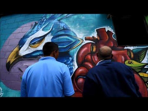 Colorful murals replace gang graffiti in El Salvador