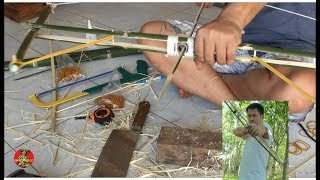 Primitive Technology: Bow and Arrows from bamboo - Traditional Archery Trick Shots