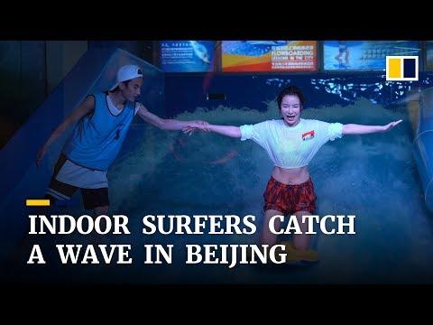 Indoor surfers, or flowboarders, catch a wave in Beijing