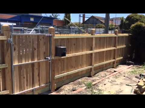 Cyprus picket fence with exposed posts, double gates and pedestrian single gate