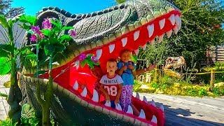 Playing with Dinosaurs! Jurassic park for children kids Alice and Dima