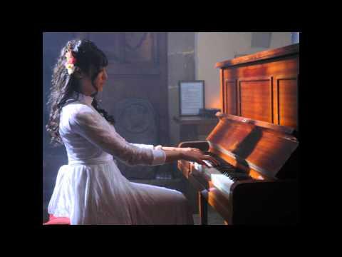 adah sharma playing the piano in 1920