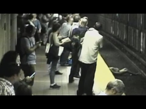 Witnesses rescue woman from train tracks in Boston