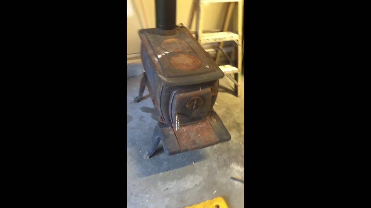Installing a wood Burning Stove in Garage in Maine - Installing A Wood Burning Stove In Garage In Maine - YouTube