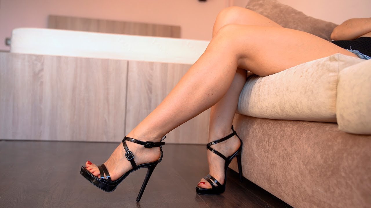 Walking on high heels showing legs and feet