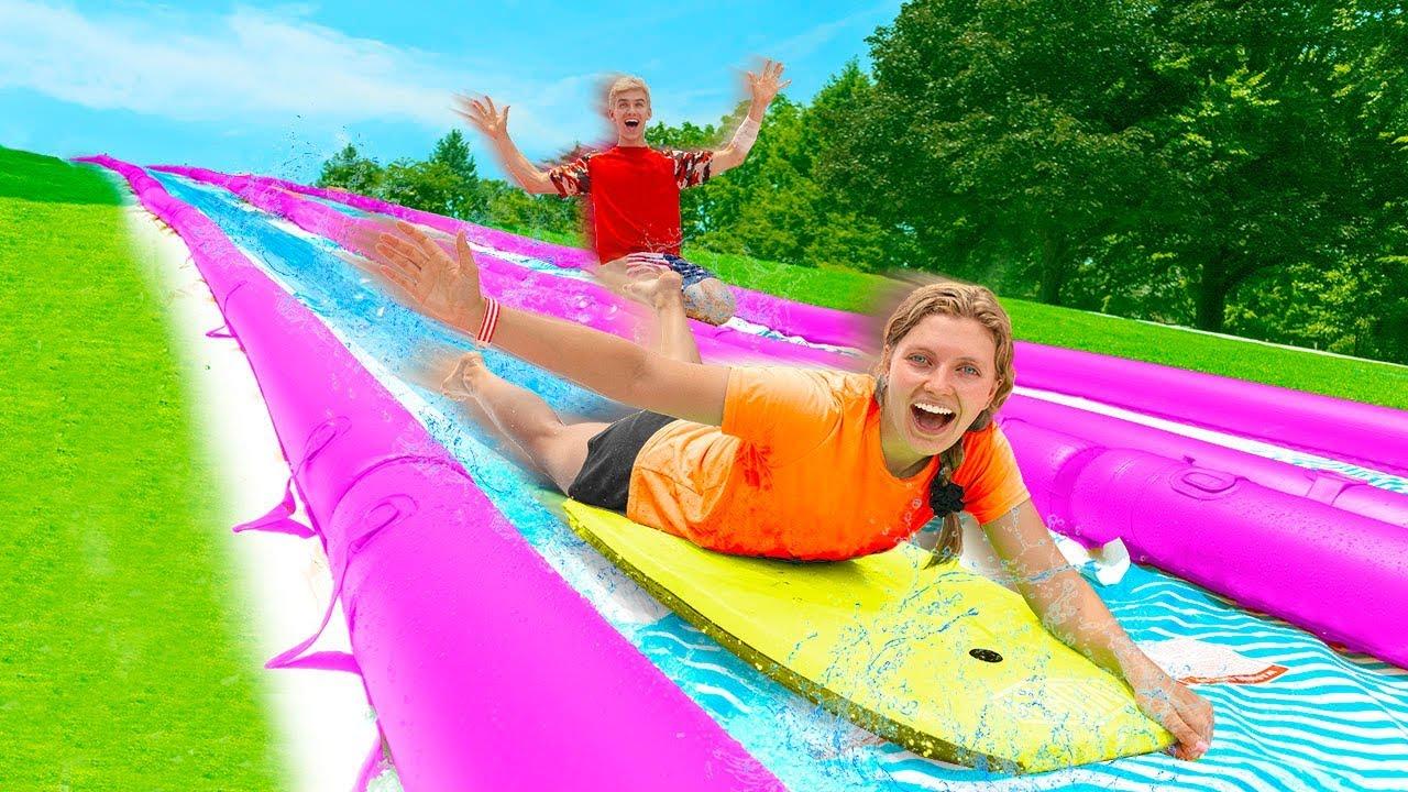 Worlds Biggest BackYard Slip N Slide Challenge!! (Winner ...