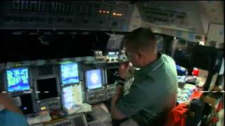 Discovery Crew Inspects Orbiter