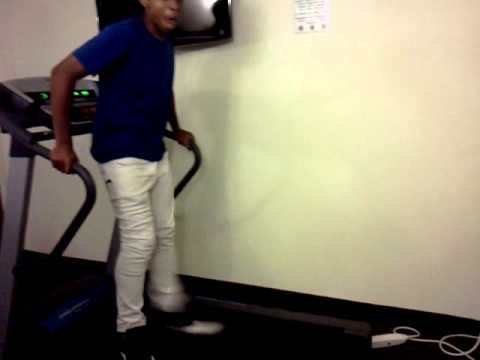 Adrian putting a hole in the wall treadmill