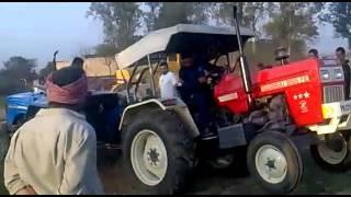 swaraj 855 vs Sonalika 60 tractors.flv