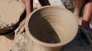 Close up of a potter preparing and designing a flower pot on a potter's wheel