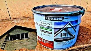 Покраска деревянного дома снаружи.