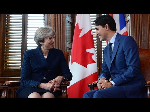 Justin Trudeau welcomes Theresa May to Canada