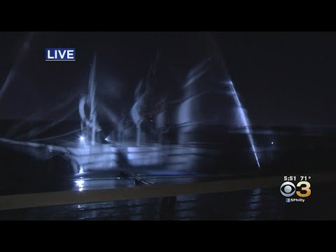 Dan Blackman - 90 ft Holograph ship is visible under the Ben Franklin for Oct- Halloween!