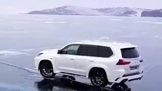 Lexus and land cruiser drifting on ice.