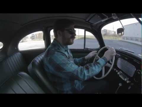 Driving a vintage Volkswagen Beetle