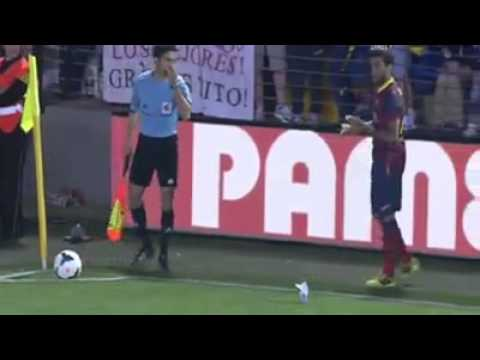 Dani Alves eats a banana on the Football field