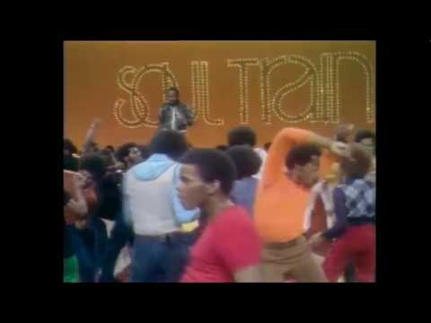 Curtis Mayfield on Soul Train performing Pusherman: Man in orange shirt laying it rough