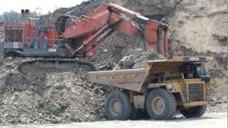 Hitachi EX2500-6 Excavator Loading a Caterpillar 777D Dump Truck