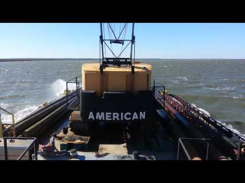 30 kts wind tug pushing Crane barge getting sale s