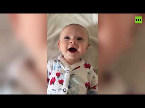 Adorable moment baby has its hearing aid turned on