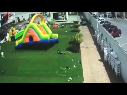Wind sends inflatable bounce house flying