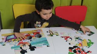 little boy plays with the Mickey Mouse puzzle . KIDS BOYS