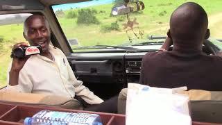 Kenyan kids on safari trip  in Masai Mara national reserve