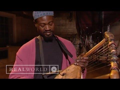 Ayub Ogada demonstrates a nyatiti (African instrument)