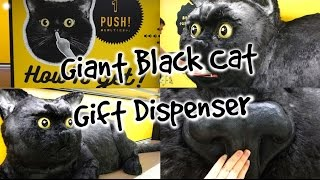 Giant Black Cat Dispenses Gifts From Its Mouth