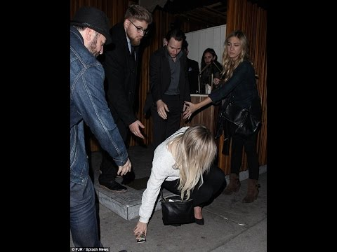 Hilary Duff takes a tumble in high heels as she leaves a restaurant... but manages to laugh it off
