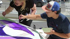 Gage Artists Paint an Italian Sports Car in Ferrari of Seattle Showroom