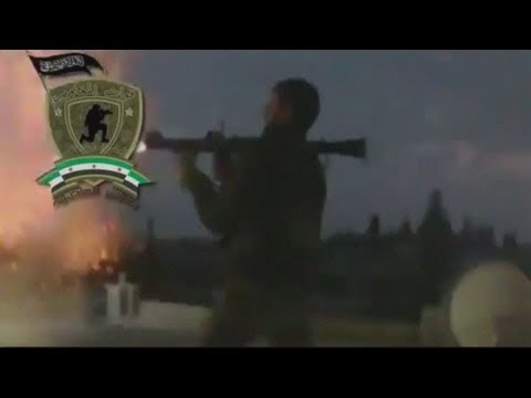 Amateur video: Syrian rebels 'capture airbase' amid heavy artillery fire