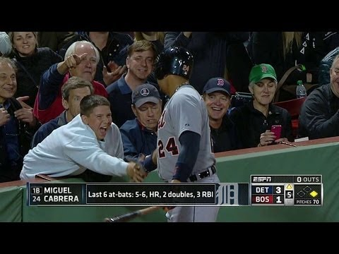 Miggy shakes a fan's hand on his way on deck