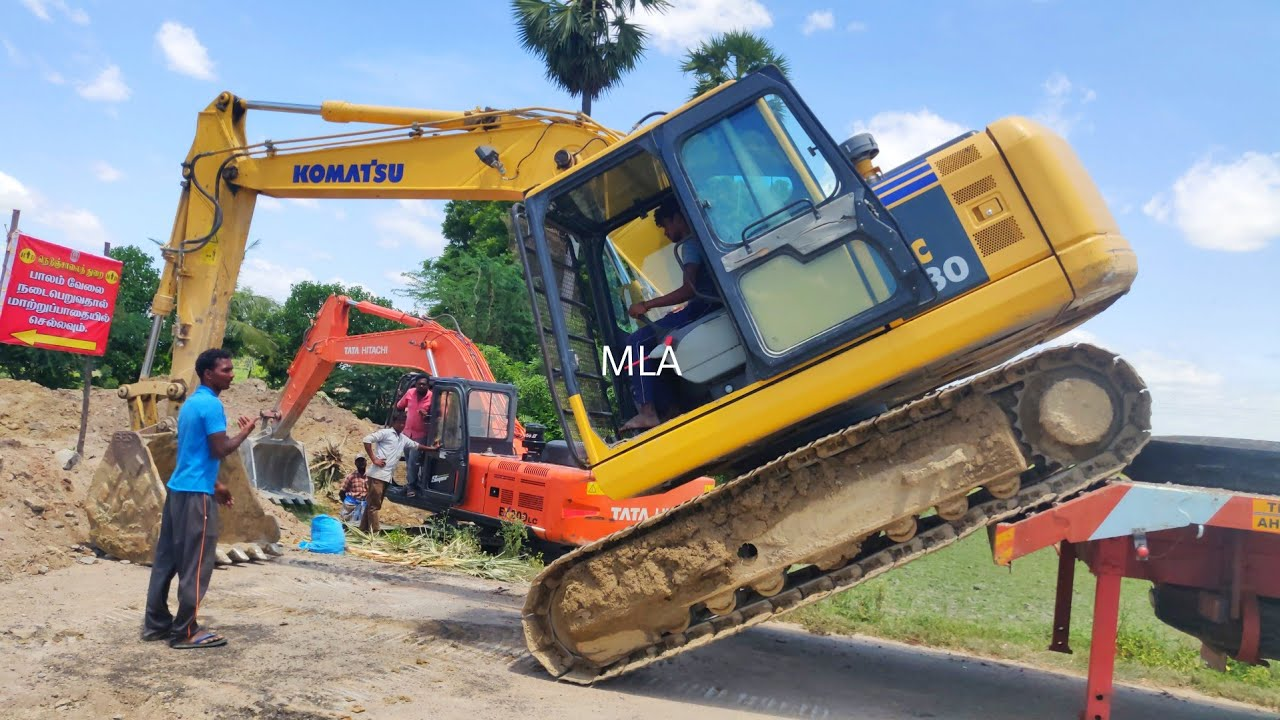 Komatsu excavator operator driving difficult place   jcb videos 3DX   excavator pulling the Komatsu