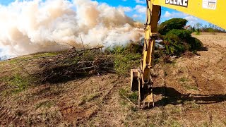 Clearing and Burning Cedar Trees so Farmer Chris can reclaim Field