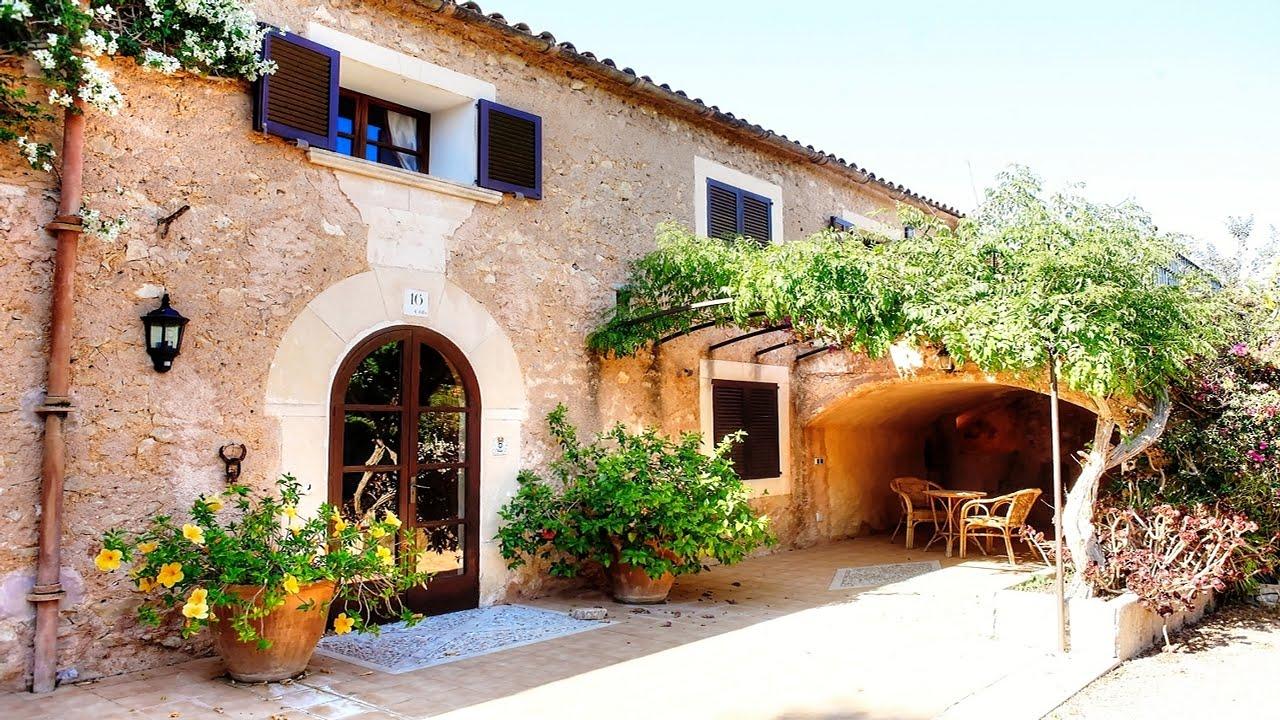 Casa antigua reformada con un jard n paradisiaco - Decoracion de casas antiguas ...