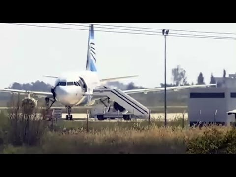 Moment EgyptAir crew member escapes hijacked plane through cockpit window