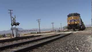 Union Pacific Freight Train Crossing Gates in Mojave Desert Motorcycles and Cars at Railroad Tracks